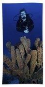 Scuba Diver Swims Underwater Amongst Bath Towel