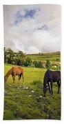 Three Horses Grazing In Field Bath Towel