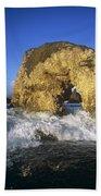 Wave Splashing Against Natural Arch Bath Towel