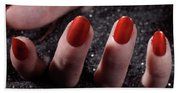 Woman Hand With Red Nail Polish Buried In Black Sand Bath Towel