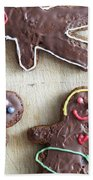 Handmade Decorated Gingerbread People Lying On Wooden Table Bath Towel