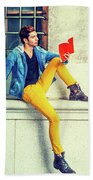 Young Man Reading Red Book, Sitting On Street Bath Towel