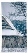 Fresh Snow Sits On The Ground Around An Old Barn Bath Towel