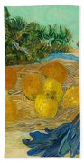 Still Life Of Oranges And Lemons With Blue Gloves Bath Towel