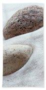 Meditation Stones On White Sand Bath Towel