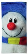 A Cute Little Soft Snowman With A Blue Hat And A Colorful Scarf Bath Towel