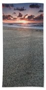 A Beach During Sunset With Glowing Sky Bath Towel