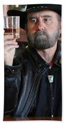 A Bearded Cowboy In Black Contemplates His Whiskey In A Saloon Bath Towel