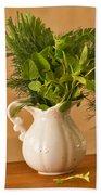 A Bouquet Of Fresh Herbs In A Tiny Jug Bath Towel