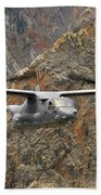 A Cv-22 Osprey Flies Over The Canyons Hand Towel