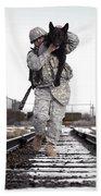 A Military Dog Handler Uses An Hand Towel