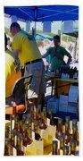 A Vendor At The Garlic Fest Offers Garlic Vinegar And Olive Oil For Sale Bath Towel