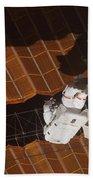 An Astronaut Anchored To A Foot Bath Towel