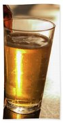 Backlit Glass Of Beer And Empty Bottle On Table Bath Towel