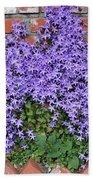 Brick Wall With Blue Flowers Bath Towel