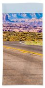 descending into Monument Valley at Utah  Arizona border  Bath Towel