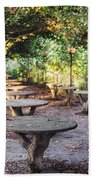 Empty Picnic Tables In The Early Fall With Fallen Leaves Bath Towel