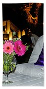 Flowers In A Vase On A White Table Hand Towel