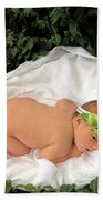 Newborn Infant Lying In Ivy Bath Towel