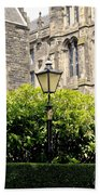 Lamppost In Front Of Green Bushes And Old Walls. Bath Towel