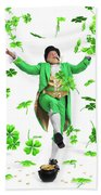Leprechaun Tossing Shamrock Leaves Up In The Air Bath Towel by Maxim Images Prints
