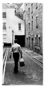 Man Walking With Shopping Bag Down Narrow English Street Bath Towel