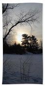 March Sunrise Behind Pines Bath Towel