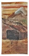 Old Farmhouse With Hay Stack In A Snow Capped Mountain Range With Tractor Tracks Gouged In The Soft  Hand Towel