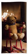 Old Teddy Bear Sitting Front Of The Fireplace In A Cold Night Bath Towel