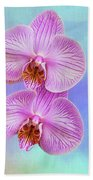Orchid Delight - Two Blooms Against A Rainbow Background Bath Towel