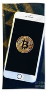 Phone With A Bitcoin Laying On Top Of It. Bath Towel