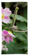 Pink Flowers Over Green Bath Towel