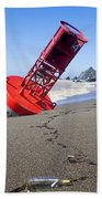 Red Bell Buoy On Beach With Bottle Bath Towel