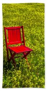 Red Chair Amoung Wildflowers Bath Towel