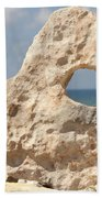 Rock With A Hole With A Tropical Ocean In The Background. Bath Towel