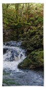 Small River Cascade Over Mossy Rocks In Northern Wales Bath Towel