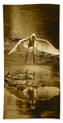 Snowy Egret Landing With Golden Tones Bath Towel