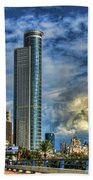The Skyscraper And Low Clouds Dance Bath Towel by Ron Shoshani