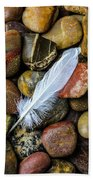 White Feather On River Stones Bath Towel