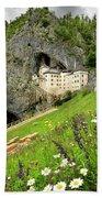 Wildflowers On Hillside At Predjama Castle 1570 Renaissance Fort Bath Towel