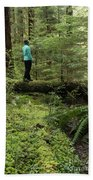 Woman On A Moss Covered Log In Olympic National Park Bath Towel
