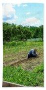 Woman Planting Garden Near Barn Bath Towel
