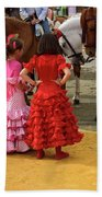 Young Girls In Flamenco Dresses Looking At Horses At The April F Bath Towel