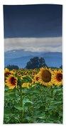 Sunflowers Under A Stormy Sky Bath Towel by John De Bord