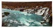 The Beautiful Cascades Of Hraunfossar In Iceland. Bath Towel