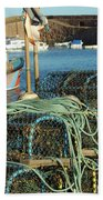 lobster pots and trawlers at Dunbar harbour Bath Towel