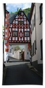 old historic street and woodframed house in Ediger Germany Bath Towel