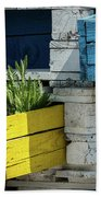 Old Pallet Painted White, Blue And Yellow Used As Flower Pot Bath Towel