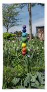 Sticks With Colorful Balls In A Garden Bath Towel
