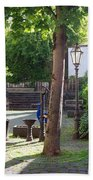 tree lamp and old water pump in Cochem Germany Bath Towel